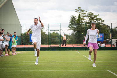 maui-jim-tennis-clinic-2014-martina-hingis-dan-bloxham-warm-up