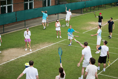 maui-jim-tennis-clinic-2014-martina-hingis-group-serving-technique