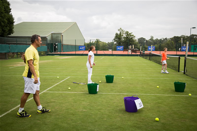 maui-jim-the-wimbeldon-club-martina-hingis-tennis-clinic-2014-balls-in-bucket