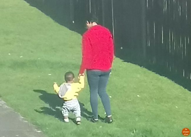 living-arrows-week-1252-ecos-first-walk-outside-mother-and-son-hand-in-hand